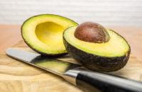 Avocado cut in half showing pit