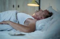 man suffering from night sweats