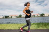 Prenant woman walks runs around a lake