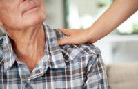 Older man being cared for