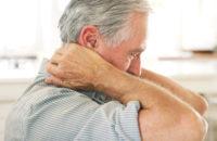 elderly man with neck pain