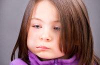 child with swollen cheek