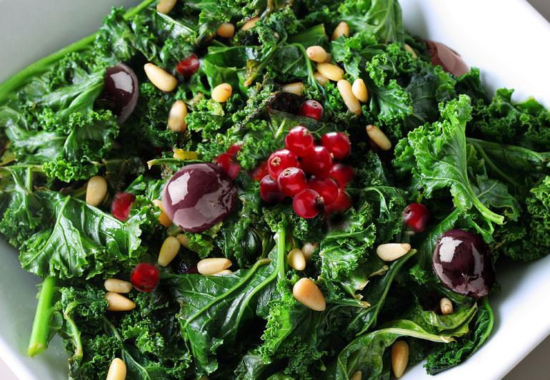 Raw Kale Salad With Pine Nuts, Currants + Kalamata Olives