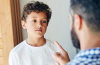 Parent lecturing misbehaving child
