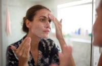 Woman adding probiotics to skin care regime