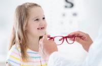 Child having eye exam at optomentrist office