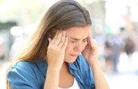 Woman experiencing a cluster headache