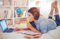 Teen studying in her bedroom